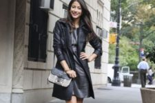 With black leather dress, printed bag and ankle strap shoes