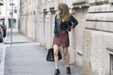 With black leather jacket, top, black tote bag and flat boots