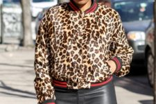 With black leather pants and leopard clutch