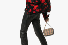 With black leather pants, printed small bag and black leather boots