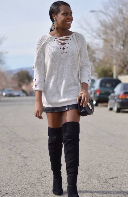 With black leather skirt, suede over the knee boots and black chain strap bag