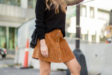 With black loose sweater, black low heeled ankle boots and bag
