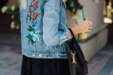With black maxi skirt and black bag