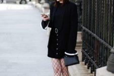 With black shirt, black hat, black blazer, bag and ankle boots