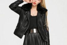 With black shirt, black pleated skirt and metallic belt