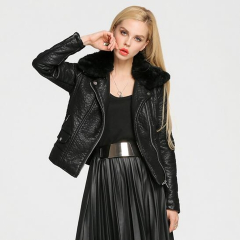 With black shirt, black pleated skirt and metallic belt
