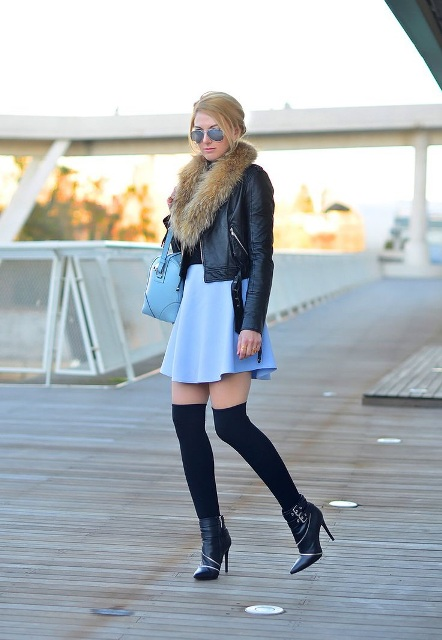 With black shirt, blue skirt, blue bag and heeled boots