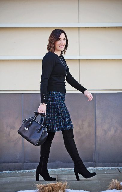 With black shirt, high boots and black bag
