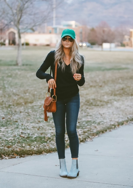 With black shirt, skinny jeans, brown fringe bag and light blue suede boots
