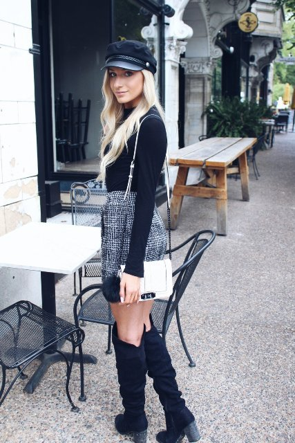 With black shirt, tweed skirt, white bag and high boots