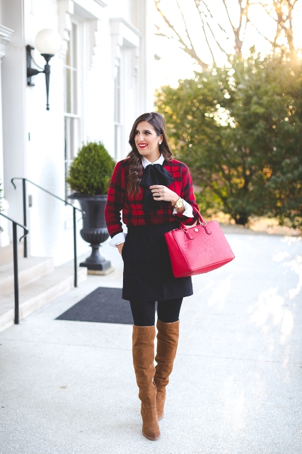 With black skirt, red bag and brown suede over the knee boots