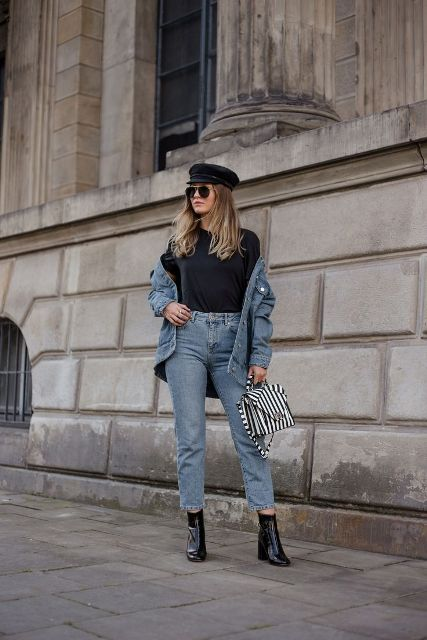 With black t-shirt, denim jacket, cropped jeans, striped bag and black ankle boots