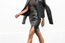 With black transparent shirt, black leather jacket and cutout high heels
