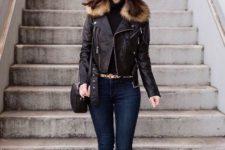 With black turtleneck, navy blue skinny jeans, black bag and beige pumps
