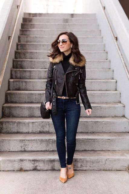 With black turtleneck, navy blue skinny jeans, black bag and beige pumps