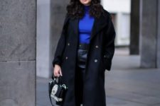 With blue turtleneck, blue beret, black midi coat, gray boots and mini bag