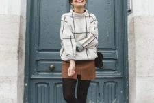 With brown mini skirt, black tights, black bag and embellished boots