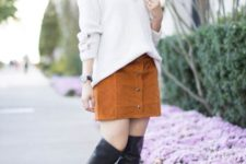 With brown suede mini skirt and black leather high boots