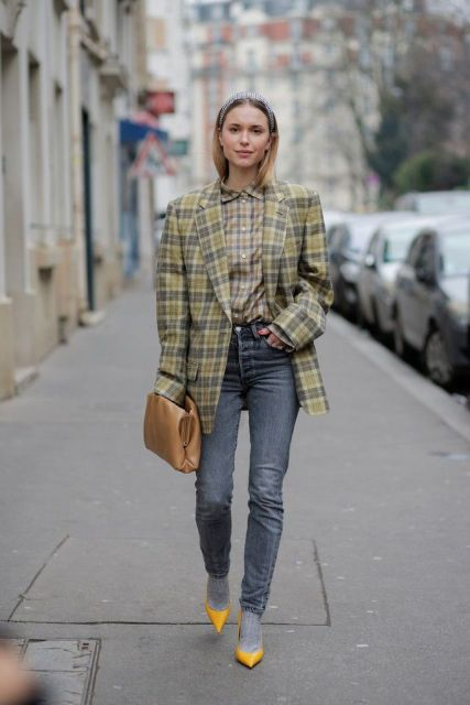 With checked button down shirt, brown clutch, skinny jeans and yellow pumps