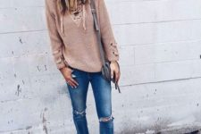 With cuffed jeans, gray bag and beige cutout ankle boots