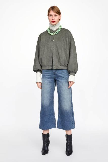 With denim culottes, black ankle boots and white turtleneck sweater