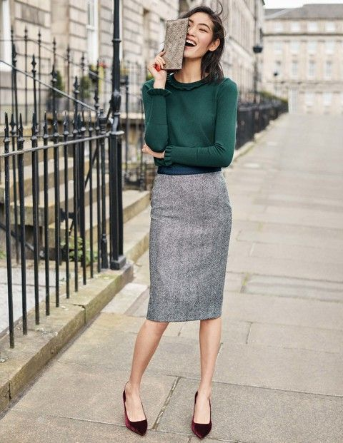 With emerald long sleeved shirt, purple velvet shoes and clutch