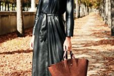 With flat shoes and brown tote bag