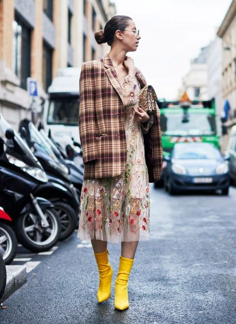 With floral midi dress, leopard clutch and yellow heeled boots