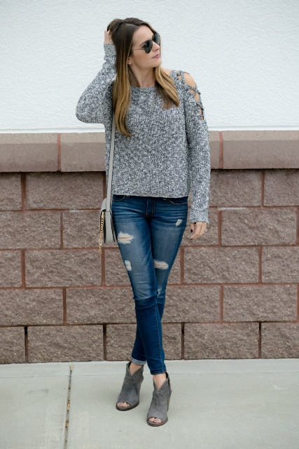 With gray bag, distressed jeans and gray cutout boots