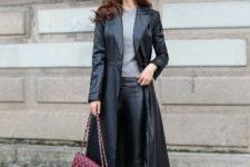 With gray shirt, black leather skinny pants and marsala chain strap bag