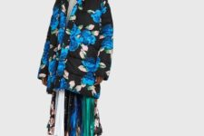 With gray shirt, printed pleated skirt and patent leather boots