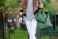 With gray t-shirt, white pants, black ankle boots and green tote bag