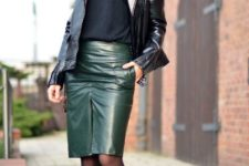 With green leather skirt, black loose shirt and ankle boots