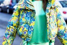 With green shirt and green satin midi skirt