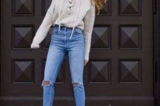 With high-waisted jeans and marsala ankle boots