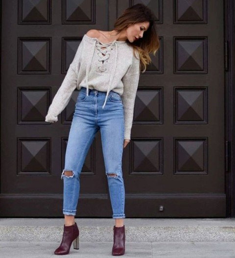 With high waisted jeans and marsala ankle boots