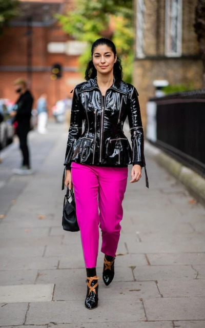 With hot pink pants, black bag and black and brown boots
