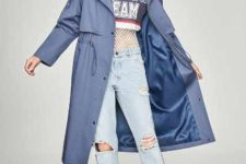 With labeled crop t-shirt, light blue distressed cuffed jeans, beige lace up boots and beret