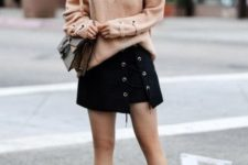 With lace up sweater, lace up mini skirt, platform shoes and chain strap bag