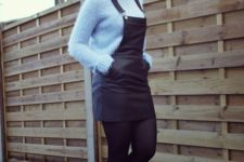 With light blue sweater and black embellished boots