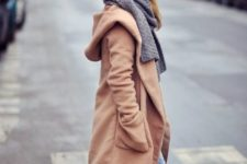 With loose jeans and gray scarf