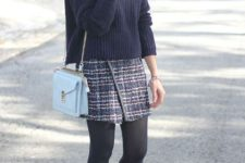 With loose sweater, light blue bag, black tights and black pumps