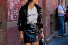 With loose t-shirt, patent leather mini skirt and bag
