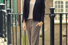 With loose top, blazer, black shoes and necklace