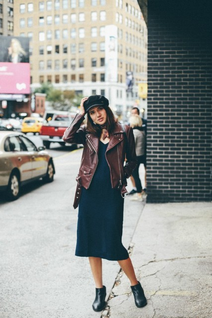 With midi dress, brown leather jacket and black ankle boots