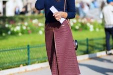 With navy blue sweater, rounded bag and black shoes