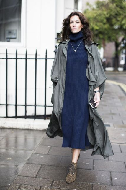 With navy blue turtleneck sweater midi dress, black bag and printed boots