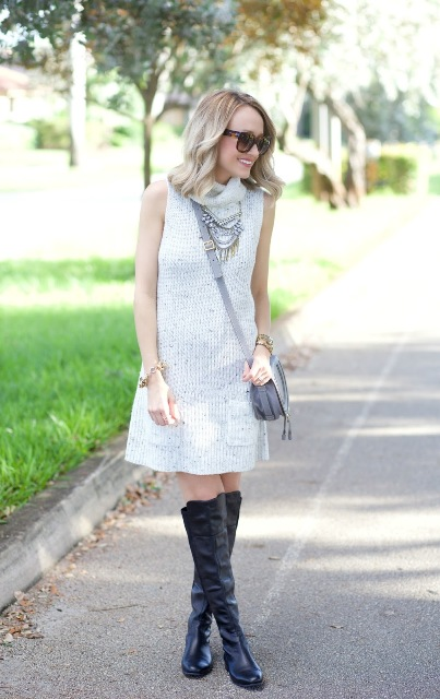 With necklace, gray crossbody bag and black leather high boots