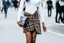 With off the shoulder top, black clutch and lace up boots