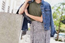 With olive green t-shirt and denim jacket
